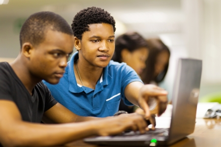 african college students using laptop together photo