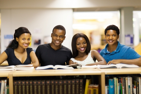 african student: group of african university students in library
