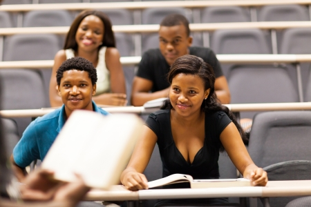 college professor lecturing group of african students in classroom photo
