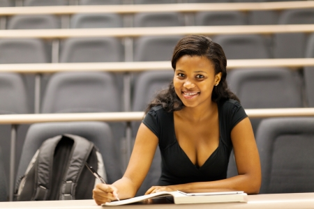 uni: female african american college student sitting in lecture hall