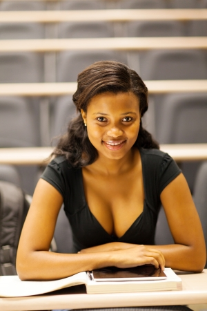 beautiful female african college student in lecture room photo