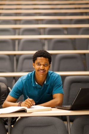 african american college boy in lecture room photo