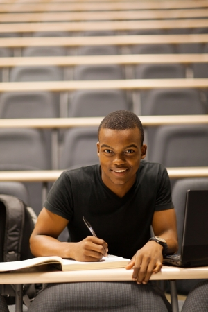 college classroom: male african american college student in lecture hall