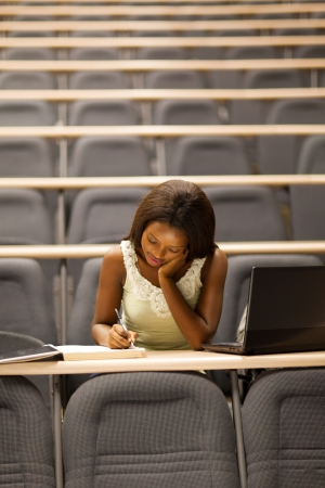 lecturing hall: female african american university student sitting in lecture room Stock Photo
