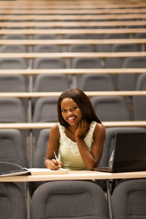 happy female african college student in lecture room photo