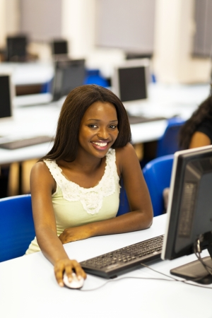 african american university student in computer room photo