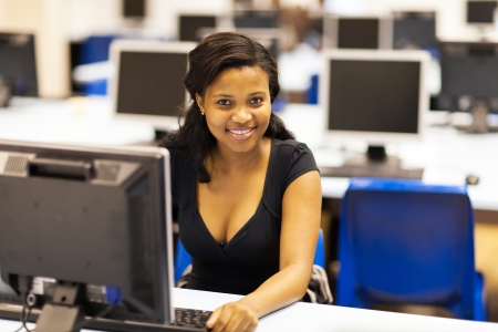 beautiful female african american college student in computer room Stock Photo - 17718253