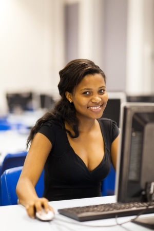 pretty female african american university student in computer room photo