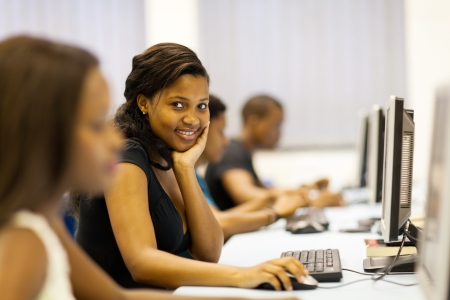computer lesson: group of college students in computer room Stock Photo