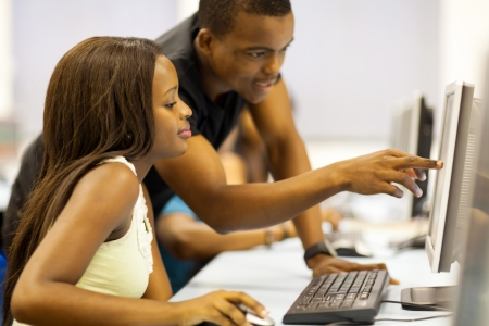 computer classroom: group of african american college students in computer room