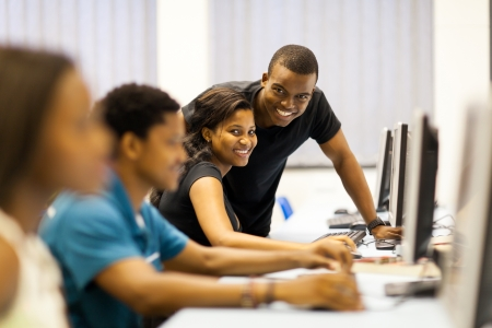 college classroom: group of african american college students in computer room