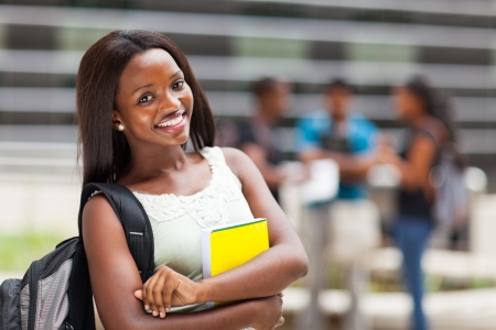 school building: beautiful young female african college student on campus Stock Photo