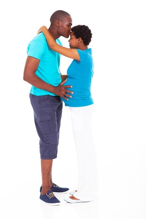 forehead: loving african american man kissing pregnant wife isolated on white