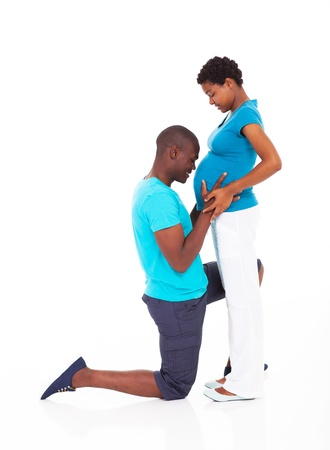 hugging knees: loving african american couple expecting baby