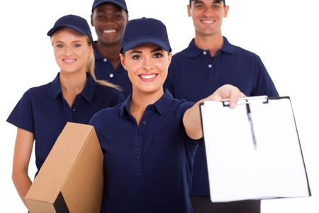 package delivery: group of professional courier service staff with parcel and signing form