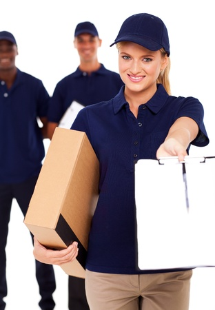 pretty delivery woman with parcel and receiving paper for signing Stock Photo - 17781873