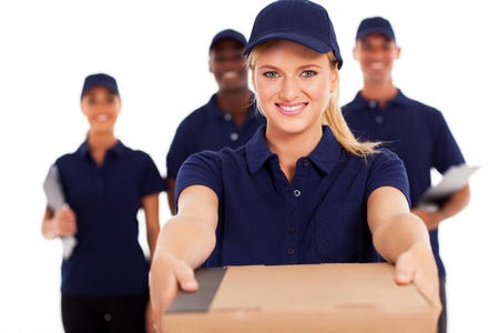 delivery package: friendly young delivery woman presenting parcel with colleagues