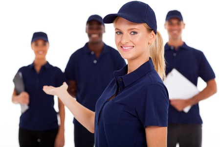 pretty female technical service worker presenting team on white Stock Photo - 17781841