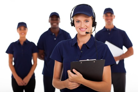 IT service call center operator with headphones and team photo