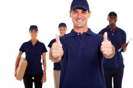 IT technician giving two thumbs up in front of colleagues photo