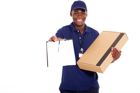 delivery package: african american delivery man carrying parcel and presenting receiving form Stock Photo