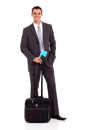 business traveller: handsome young businessman with trolley bag and air ticket