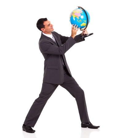 young businessman holding a globe isolated on white photo
