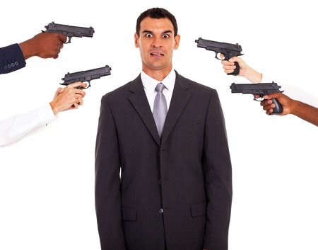 office politics: businessman being attacked at gun point by colleagues