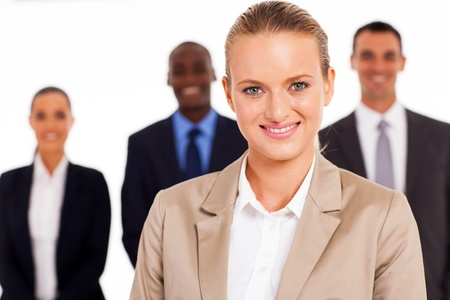 pretty young businesswoman in front of colleagues Stock Photo - 17781875