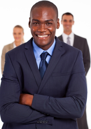 african american male: handsome african american businessman in front of team