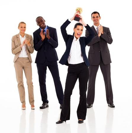 congratulating: business team applauding when businesswoman winning a trophy