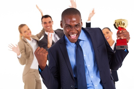 half dressed: excited african american businessman winning a trophy