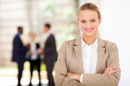 well dressed girl: beautiful blond businesswoman portrait in office Stock Photo