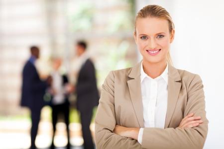 lovely businesswoman: beautiful blond businesswoman portrait in office Stock Photo