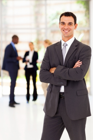 half dressed: handsome businessman arms folded portrait in office Stock Photo