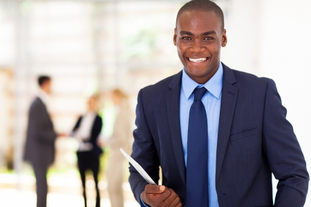 white collar workers: handsome african american businessman with tablet computer in office Stock Photo