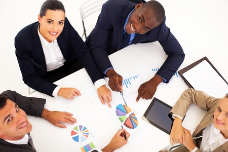 overhead view of group of business people having meeting together Stock Photo - 17781703