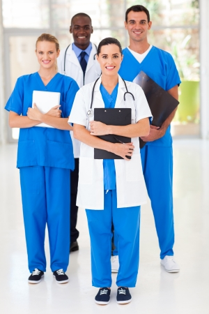 healthcare workers: group of medical workers full length portrait in hospital