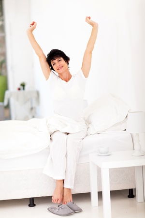 mid morning: beautiful mid age woman getting up in the morning Stock Photo