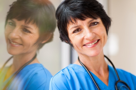 beautiful middle aged healthcare worker closeup portrait photo