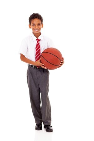 cute elementary schoolboy holding a basket ball isolated on white photo