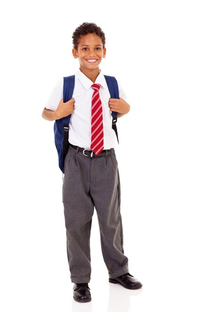 male elementary school student with backpack isolated on white photo