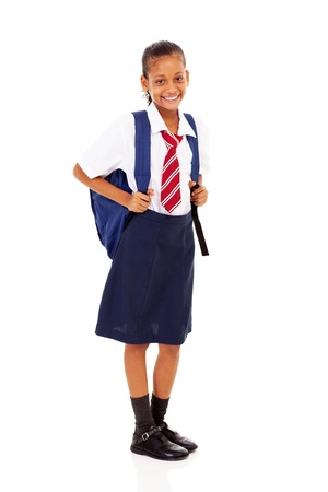 elementary schoolgirl full length isolated on white photo