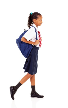 female elementary school student walking on white photo