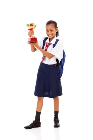 trophies: cute primary schoolgirl holding a trophy isolated on white Stock Photo