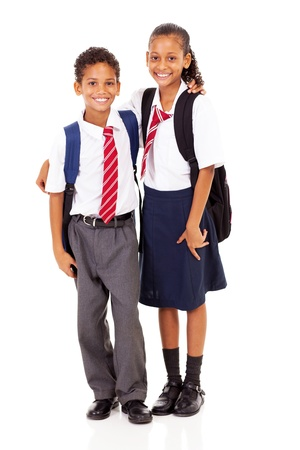 two elementary school students full length isolated on white photo