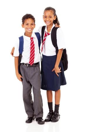 school girl uniform: two elementary school students full length isolated on white Stock Photo