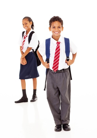 two primary school students standing on white Stock Photo - 18075467