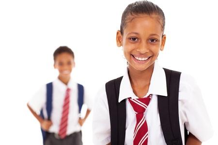 cute elementary schoolgirl in front of classmate Stock Photo