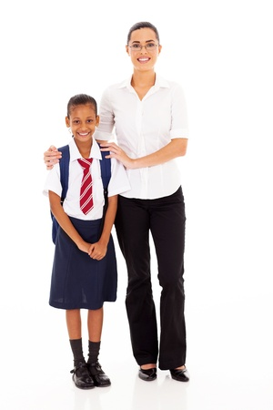 elementary schoolgirl and teacher full length portrait on white photo